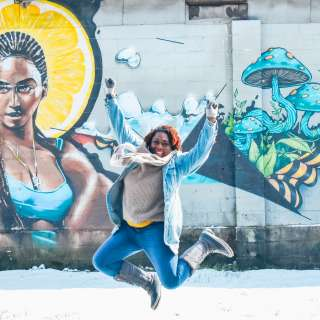 Jumping for joy in front of the Beyonce mural in Asheville's River Arts District