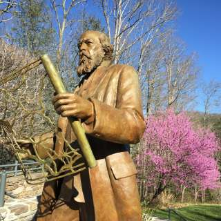 A statue of Olmstead lives at the NC Arboretum in Asheville