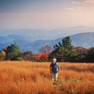 hiker on top of mountain in fall