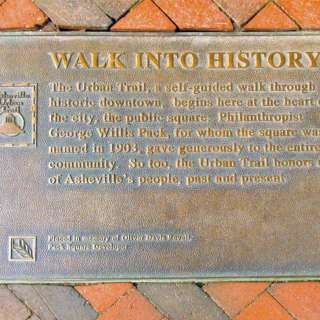 Iron Plaque that says Walk into History