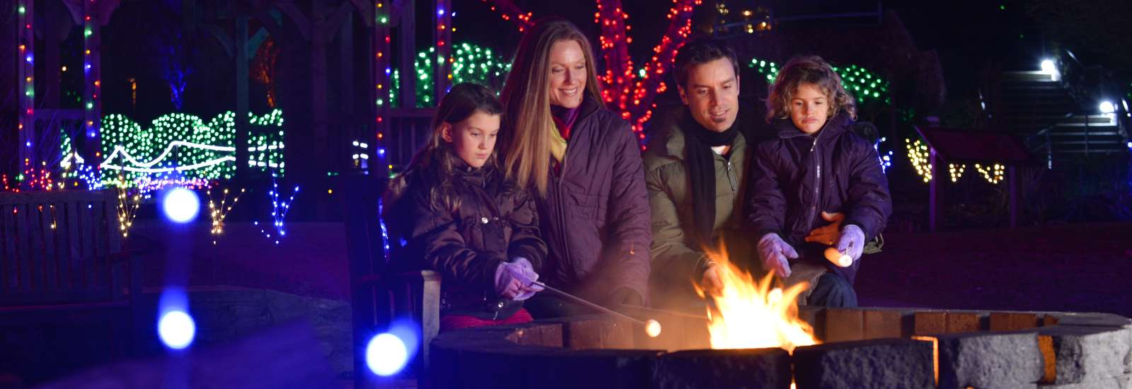 Family Making Smores at Winter Lights
