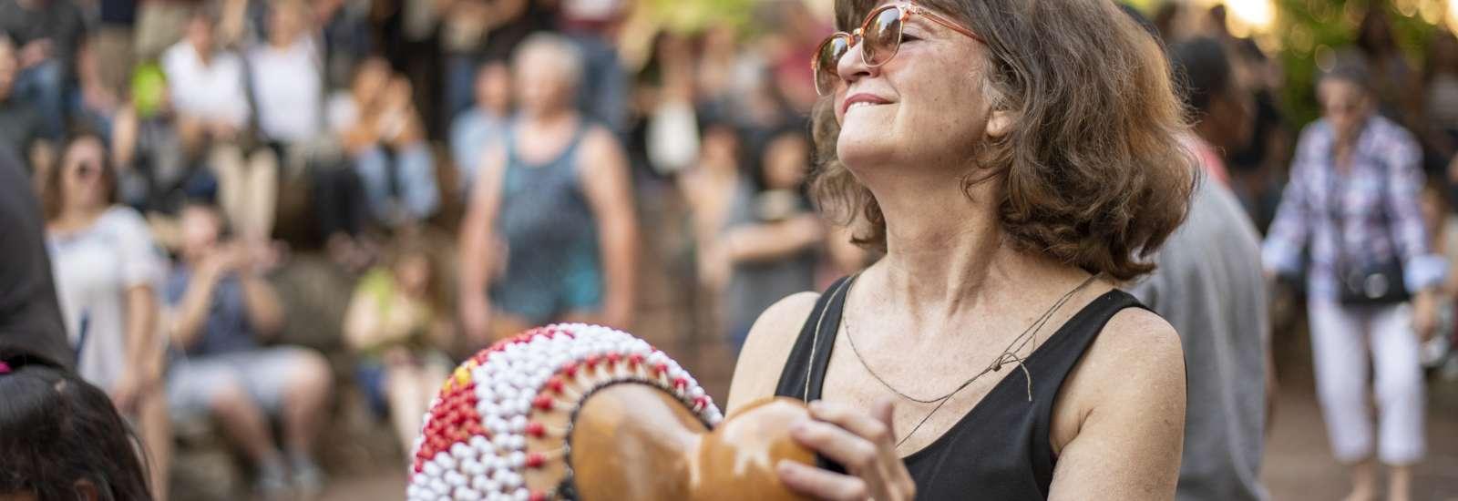 Woman dancing at drum circle in Asheville, N.C.