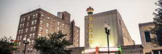 The Downtown Bryan skyline, anchored by The Queen Theatre
