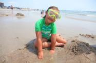 Girl with Goggles Playing on Carolina Beach