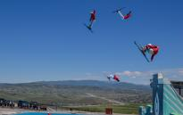 Freestyle Skiers Jump into a Pool at Utah Olympic Park