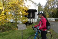 Covered Bridges Scenic Bikeway Sign in Fall by Natalie Inouye