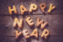 Cookies spelling out happy new year.