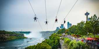 With four parallel ziplines facing the American Falls and the mighty Canadian Horseshoe Falls, riders dangle from a thrilling 67 metres (220 feet) high above the Niagara River at the WildPlay Zipline