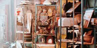 Objects on shelves at a flea market