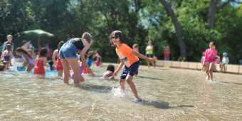 Kids playing in the sprinklers at Toronto's High Park