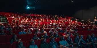 People watching a movie in a movie theatre