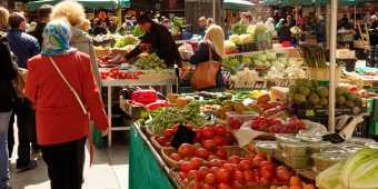 People walking through a flea market