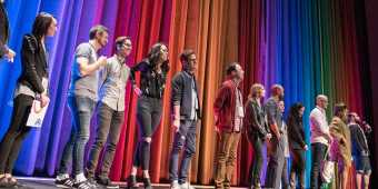 People onstage at the Inside Out Film Festival in Toronto