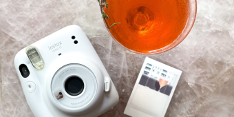 A Polaroid camera and cocktail at the Four Seasons Hotel Toronto