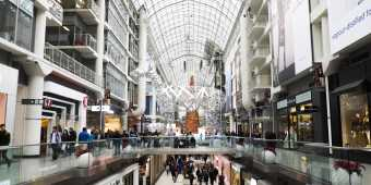 Holiday lights and decor inside the Toronto Eaton Centre in winter