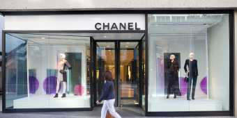 A woman walks past the Chanel store in Toronto's Yorkville neighborhood