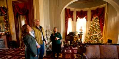 Couple touring the Culbertson Manion during Christmas