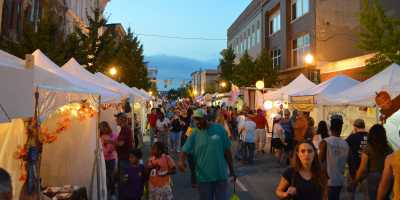booths line the street at Harvest Homecoming