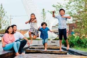 Family at Kids' Canal at Promenade Park