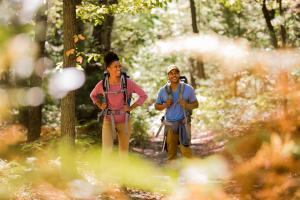 Couple with backpacks hiking the Appalachian Trail