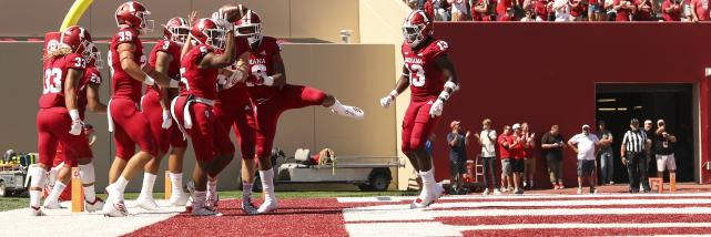Hoosiers celebrating a touchdown on the field