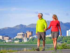Tony Knowles Coastal trail walking trip with Anchorage, Alaska's city skyline in the background