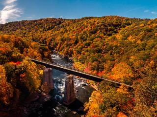 Stunning Aerial Fall Foliage View from Great Allegheny Passage rail trail in Ohiopyle State Park
