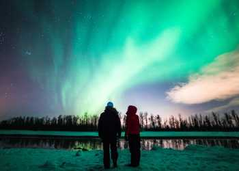 The northern lights, or aurora borealis, add vibrant color to winter nights near Anchorage, Alaska.