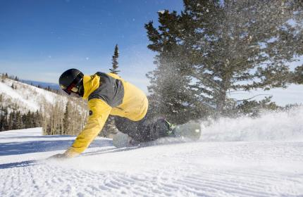 Snowboarder on groomer at Park City Mountain