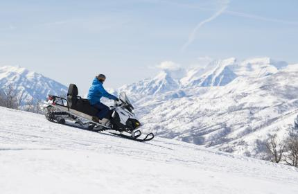 Snowmobile on Ridge with Timpanogos in the background