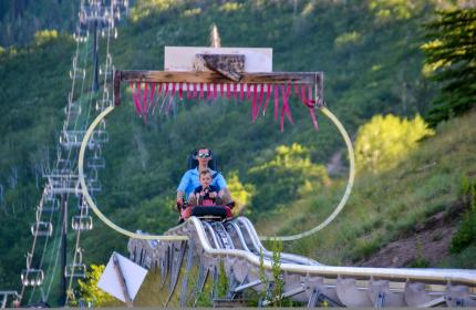 Father and Son ride down the alpine coaster at Park City Mountain