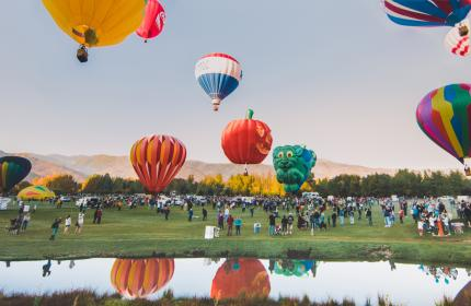 a group of hot air balloons taking off into the air