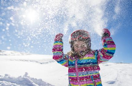 Little Girl Throwing Snow during a day of skiing at Deer Valley Resort