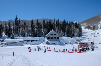 Winter day with Skiers by the Silver King mine building and Bonanza Chairlift