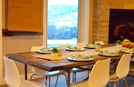 a beautiful table setting with stunning views of the mountains