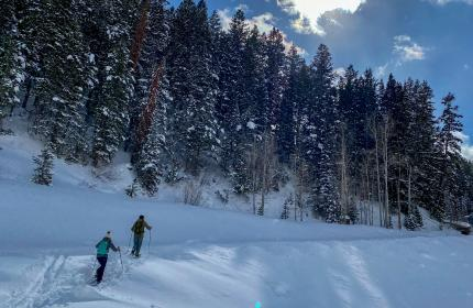 Two people snowshoeing through snow