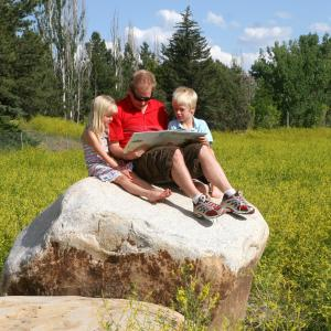 kids resting on a rock
