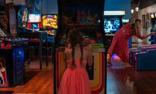 Mother and daughter playing games at Transmission Arcade