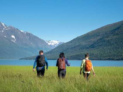 Hikers stroll the lake shore at Eklutna Lake north of Anchorage.