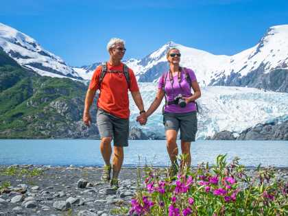 Portage Glacier awaits at the far end of Portage Pass Trail. A couple strolls the lake.
