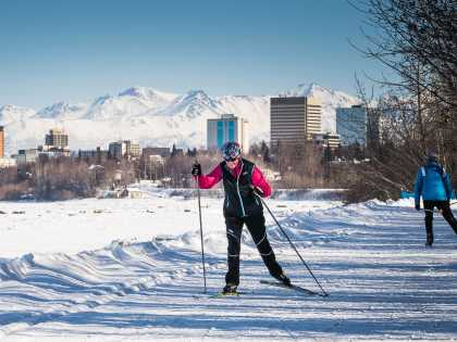 Skiers on the Coastal Trail near downtown Anchorage.