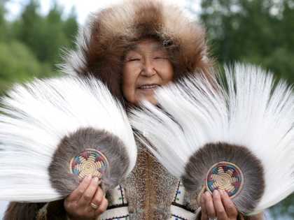 Alaska Native people; woman with Yupik dance fans