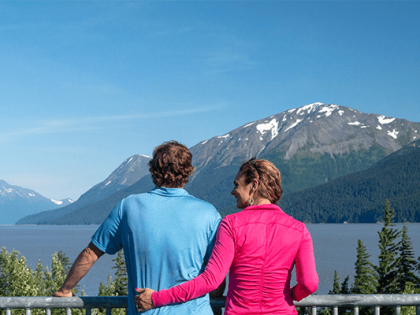 Couple viewing the mountains and inlet on a Turnagain Arm tour