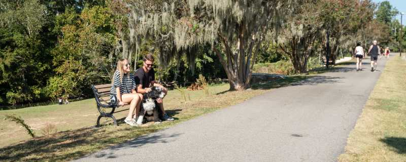 Couple Sitting On A Bench On The Three Rivers Greenway In Columbia, SC