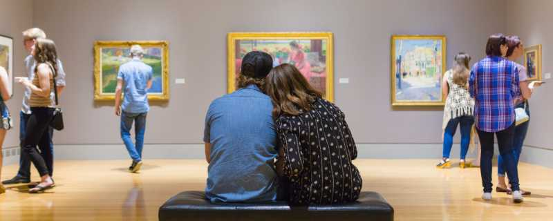 Visitors admire the artwork on display at the Columbia Museum of Art.