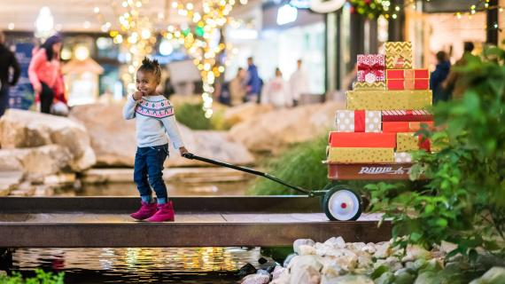 Little Girl Pulling Wagon of Presents at City Creek Center
