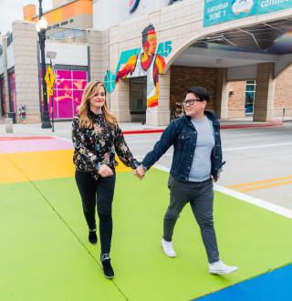 Two women walking holding hand in Salt Lake