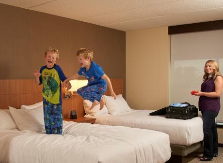 Kids on bed at Hyatt