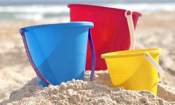 A colorful array of sand buckets on the beach