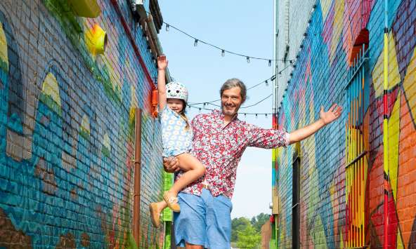 "Dad and daughter skateboarding by ""Alley on State"" mural in West Columbia (Vagabond3 visit)."